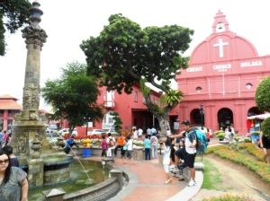 Strolling around Melacca Town Square with my backpack.