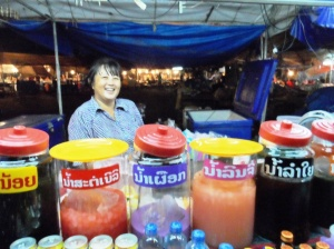 A sweet lady selling local juices in downtown Vientiane.