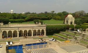 The Oberoi Amarvilas Agra pool side. With the towers of the Taj peeping from the lush treepark surrounding it.