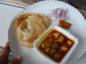 My First Street Food , some fried roti and Kari