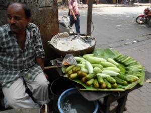 Indians eat sliced cucumber like ordinary fruit  as sold on the streets.