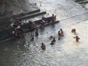 People bathing in Hooghly  River  near the market . and As I knew, This river is from the Ganges of Varanasi, which was the holy river for hindu cremation