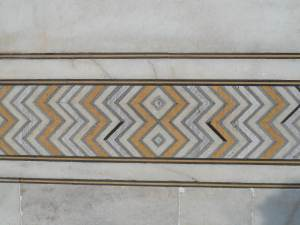 Moulding designs on the walls of the tomb. These designs are made of cut out stones , and not paint.