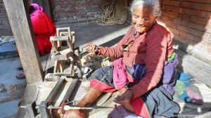 Old Lady Spinning Cotton to Yarn, the old fashion way.