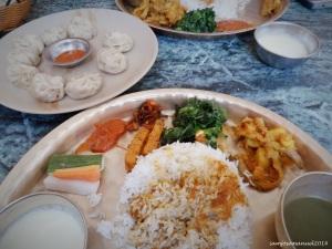Daal Bhat , Nepali Traditional Vegetarian food . with some momos/dumplings