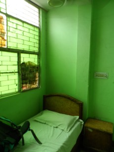 Hotel Yes Boss' Cheap Non air Bedroom for only 250 INR . around 4-5 usd , the cheapest Ive found along Main Bazaar, PajarGanj