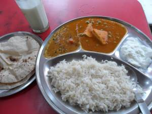 A cheap Vegetarian Thali / Meal , with Lassi (Yogurt Drink ) This is around 60 INR (1 USD)