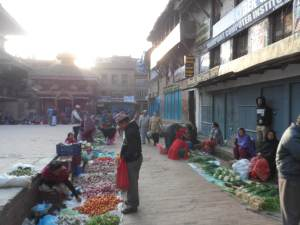 The corners of Nyalapola Temple square are occupied by vegetable and spice vendors in the morning