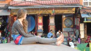 A tourist finding her nice corner at Boudanath Stupa