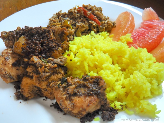 Sampling a traditional dish from the Kagan Tribe of Davao. The Tininuan is an Indigenous spicy chicken dish sauteed in shredded/roasted coconut flesh.  On the side is a Kagikit, a mildly spiced shedded fish dish. The Yellow rice prepared in coconut milk and turmeric.